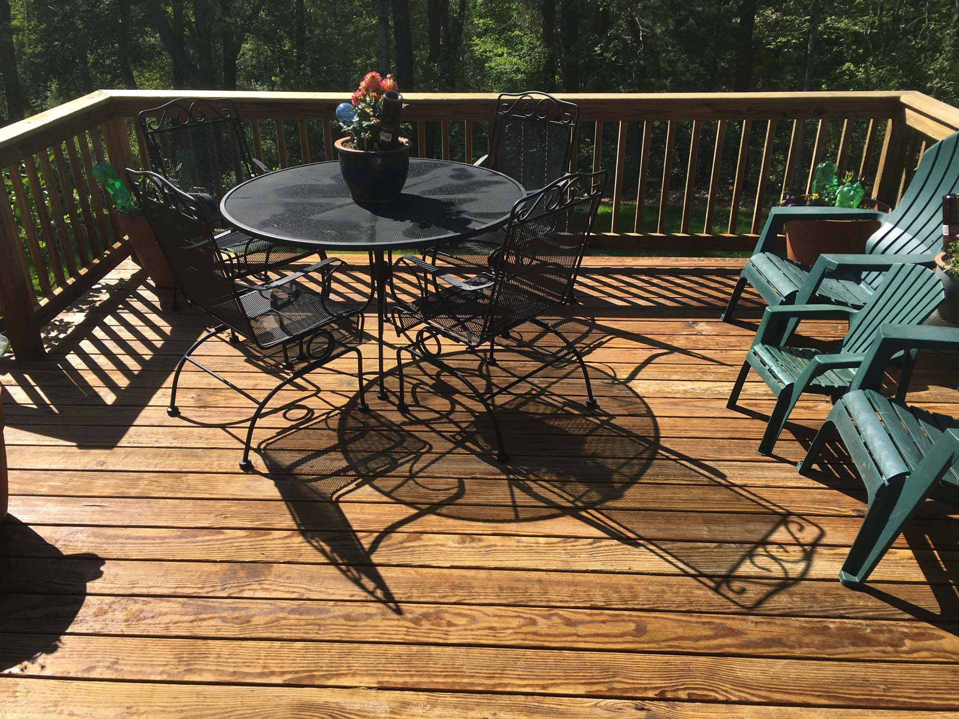 deck with table & seating after cleaning & stain