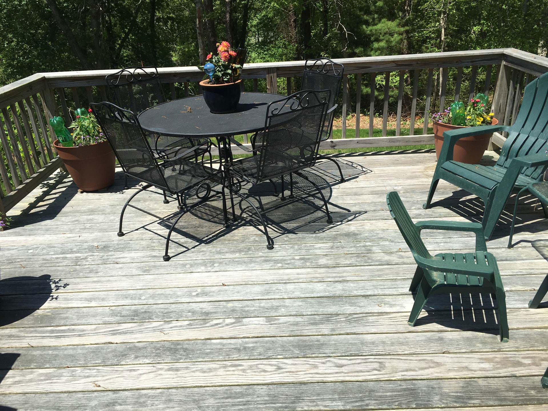 deck with table & seating before cleaning & stain